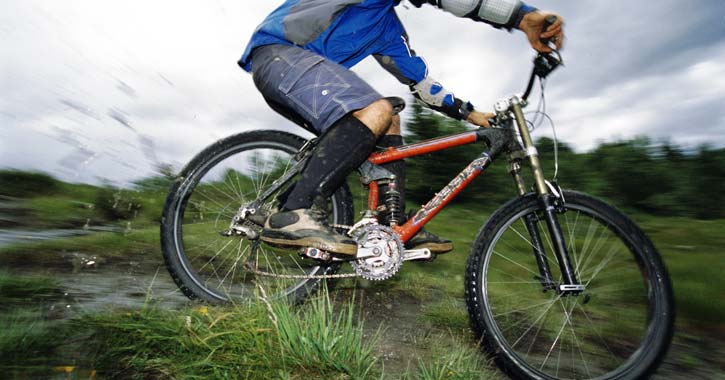 a person going fast on a mountain bike