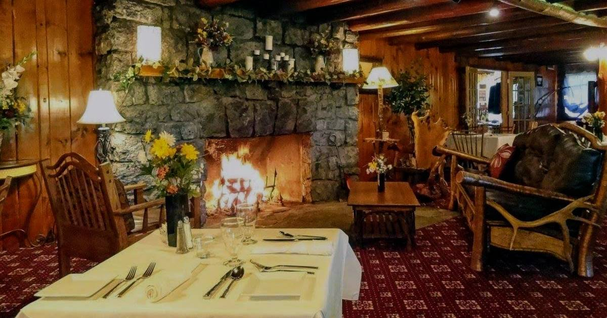 blazing fireplace near tables