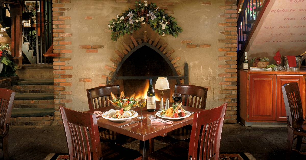 dinner and wine set up by fireplace
