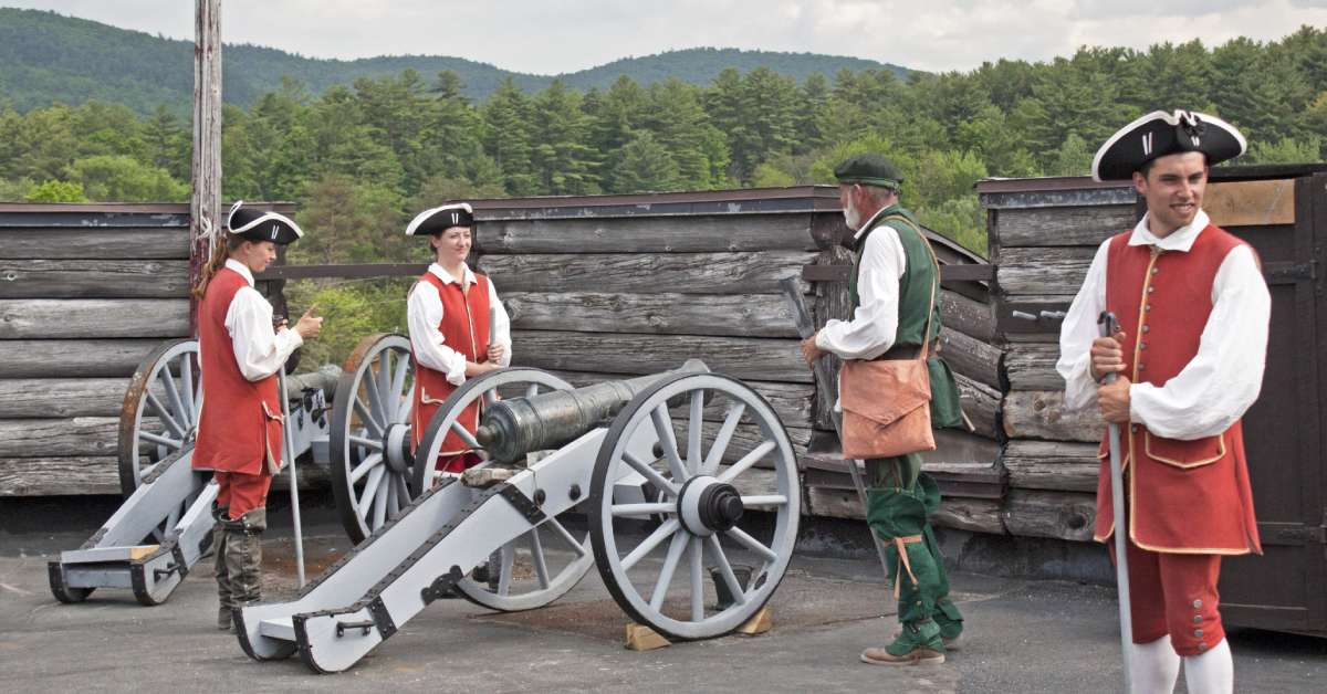 reenactors with a cannon at fort william henry
