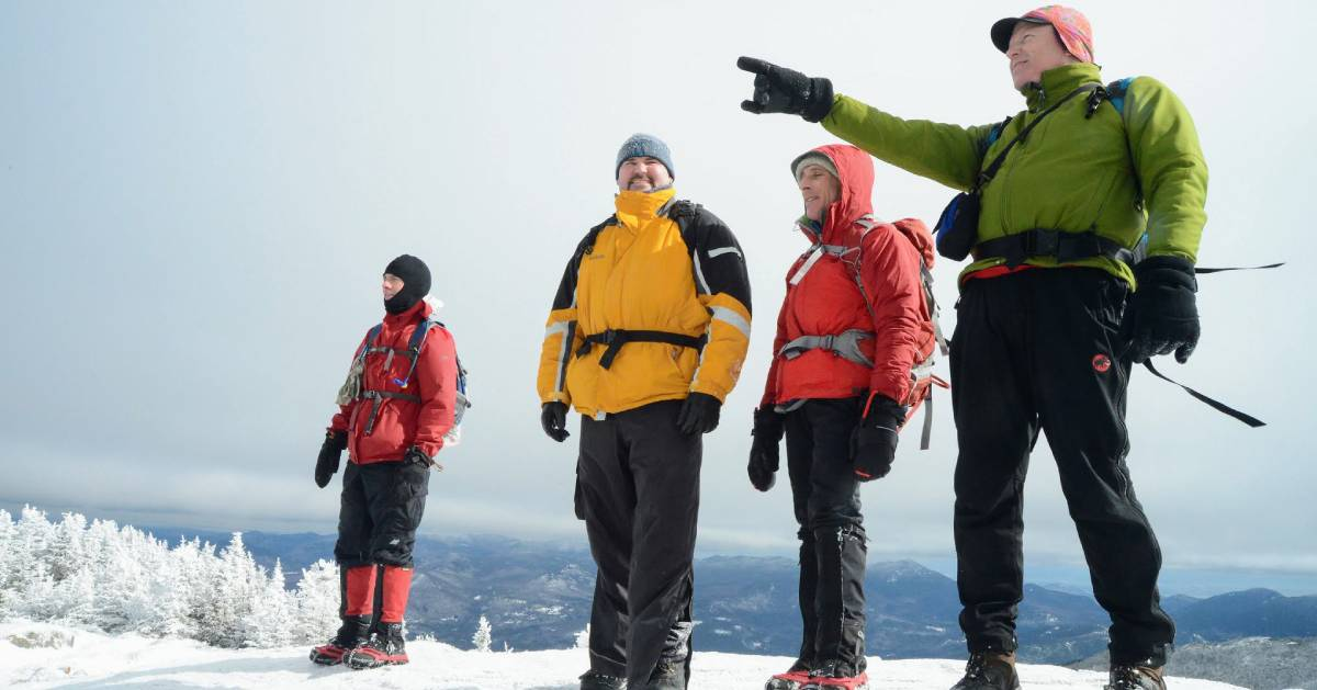 four winter hikers on mountain