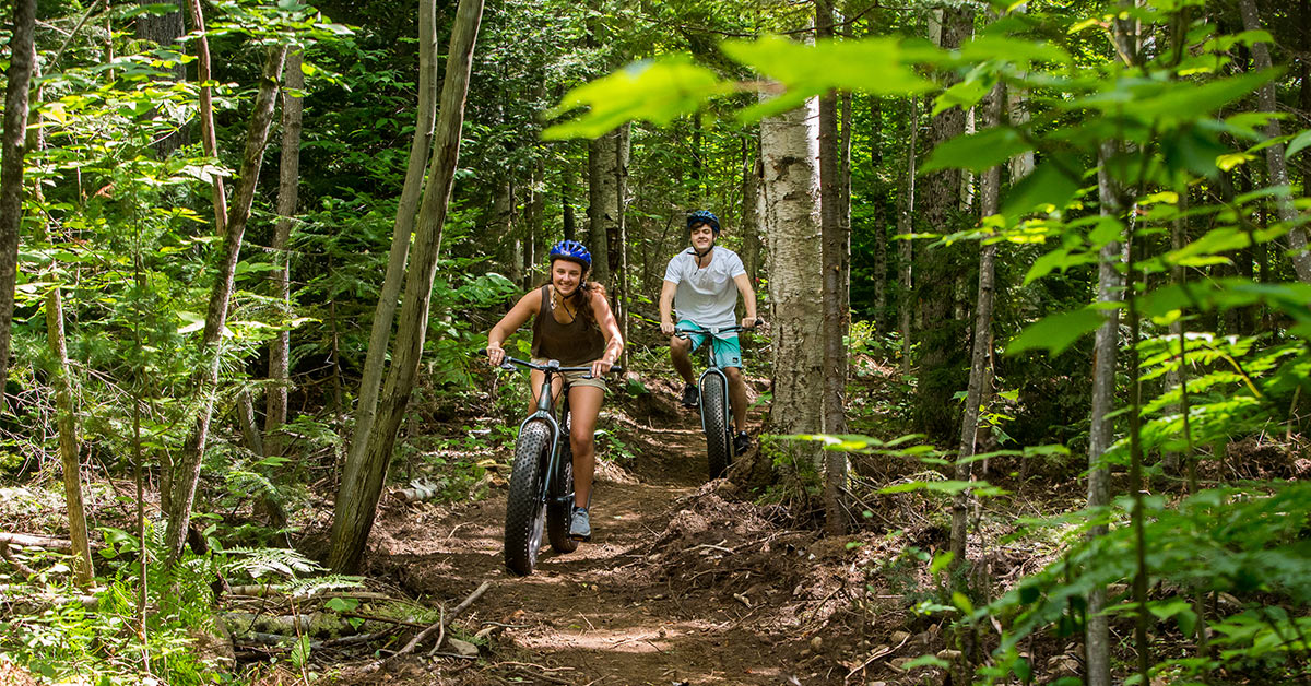 two young adults riding fat tire bikes