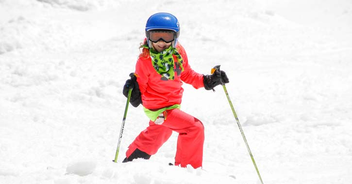 a girl skiing in snow