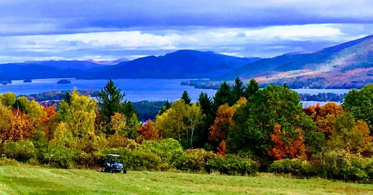golf cart on golf course with fall foliage
