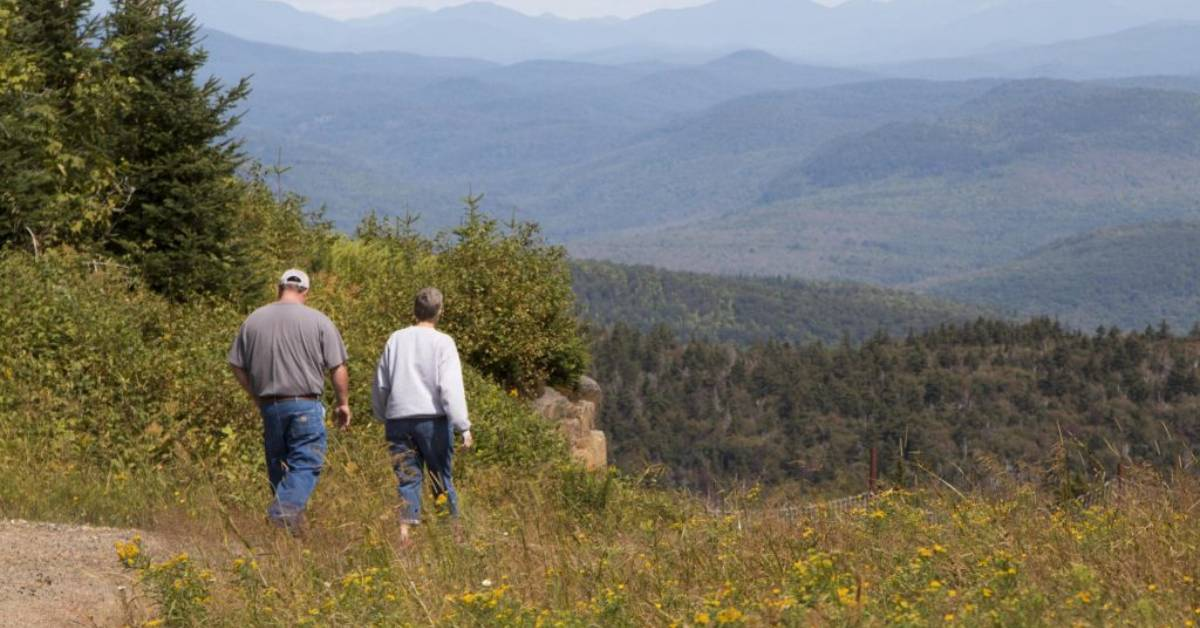 two people hiking on mountain trail