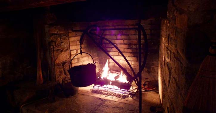 fireplace with a pot