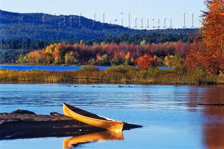 canoe in lake in fall