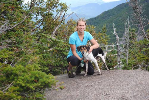 woman at summit with dog