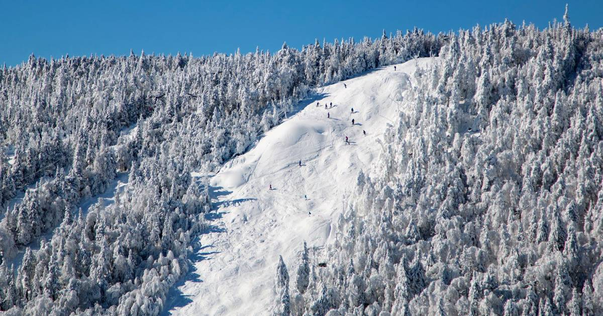huge mountain with skiers