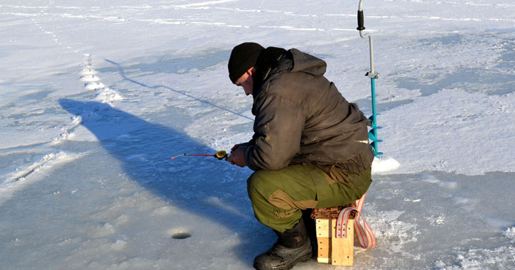 an ice fisherman on the ice