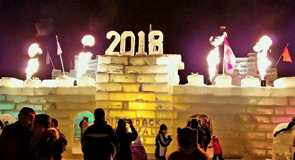 people taking photographs of an ice palace