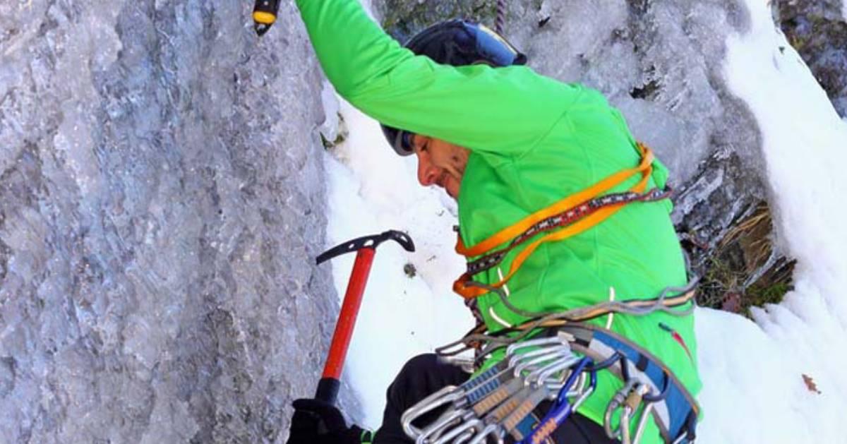a man climbing ice