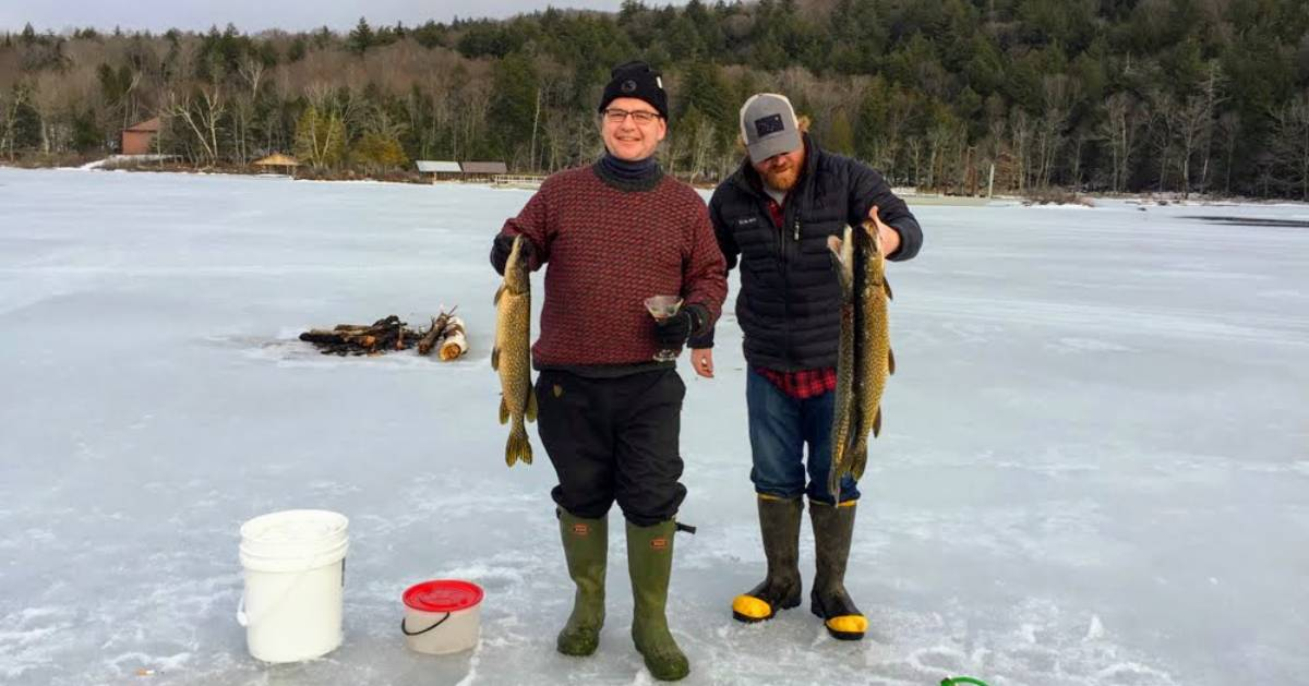 two guys with fish they caught ice fishing