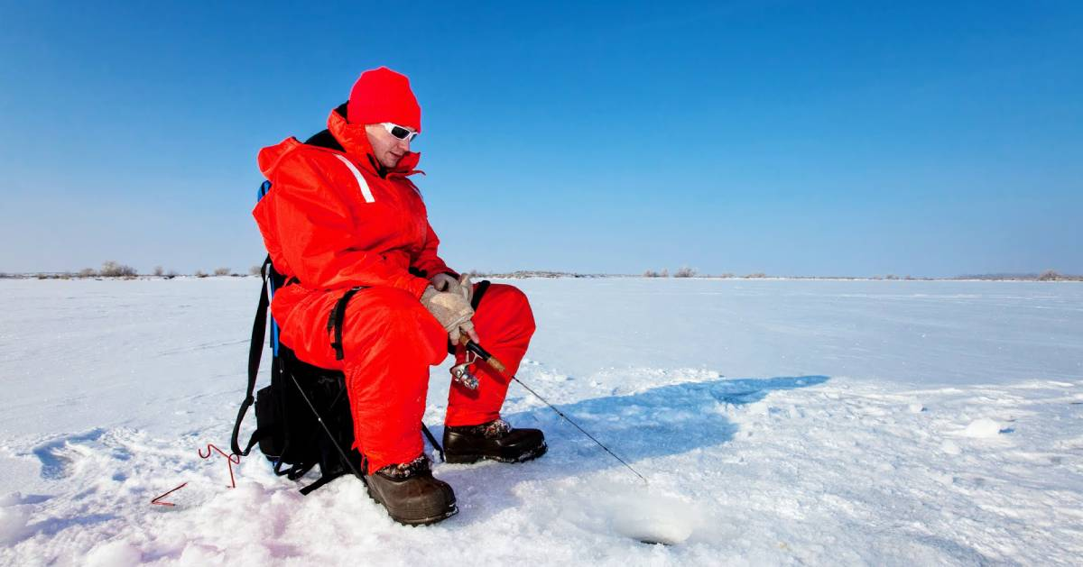 guy in red ice fishing