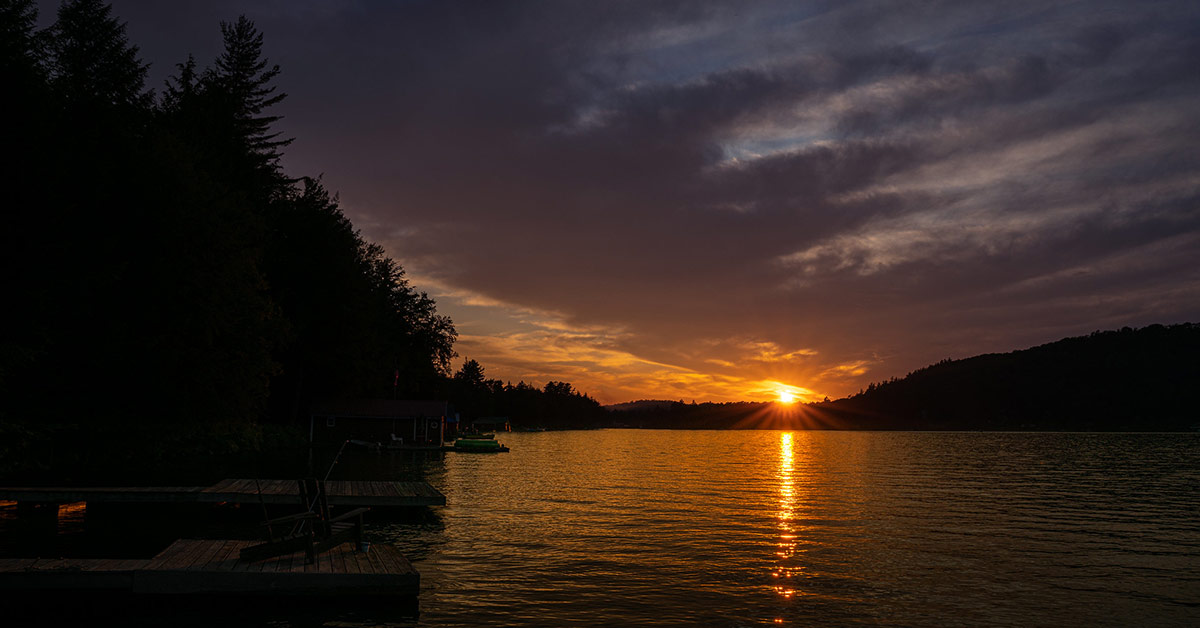 sun setting over seventh lake