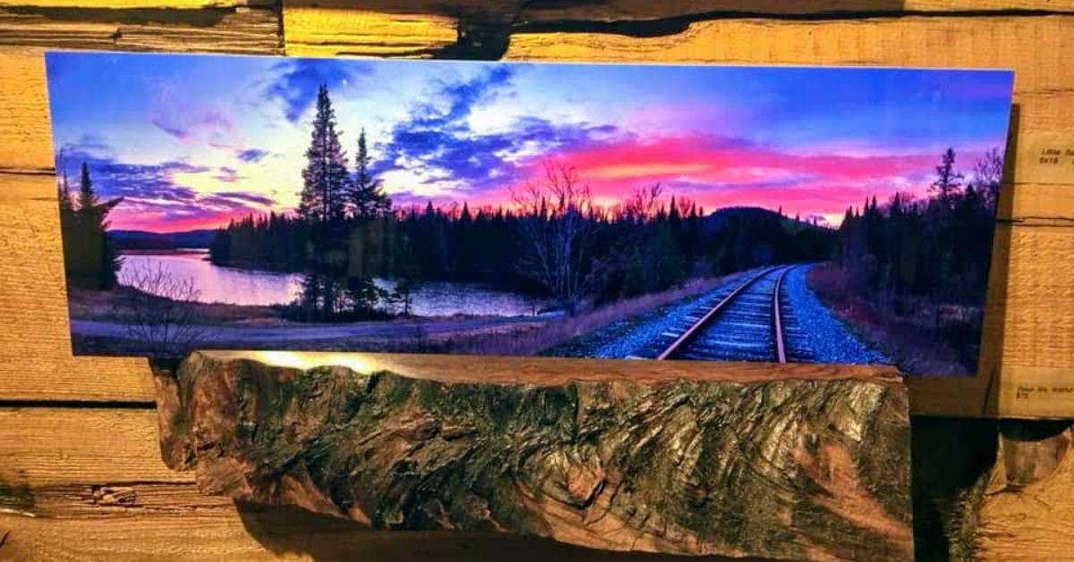 Adirondack painting on shelf