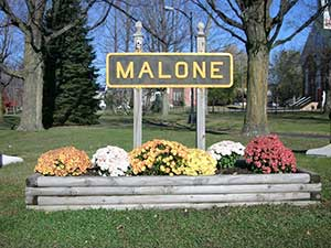 Malone sign with Flowers