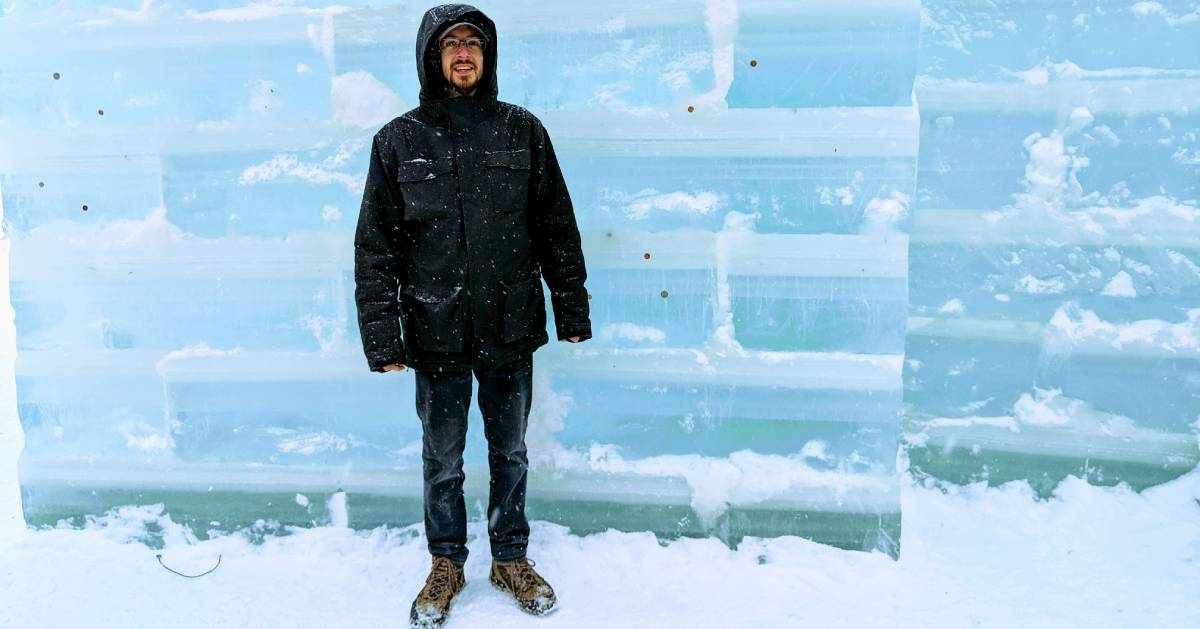 man in front of ice palace