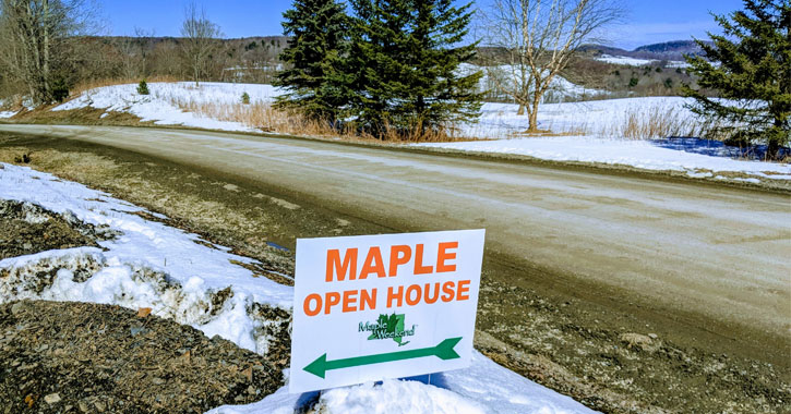 a sign for a maple open house