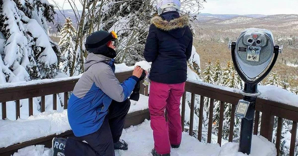 a skier proposing by scenic overlook