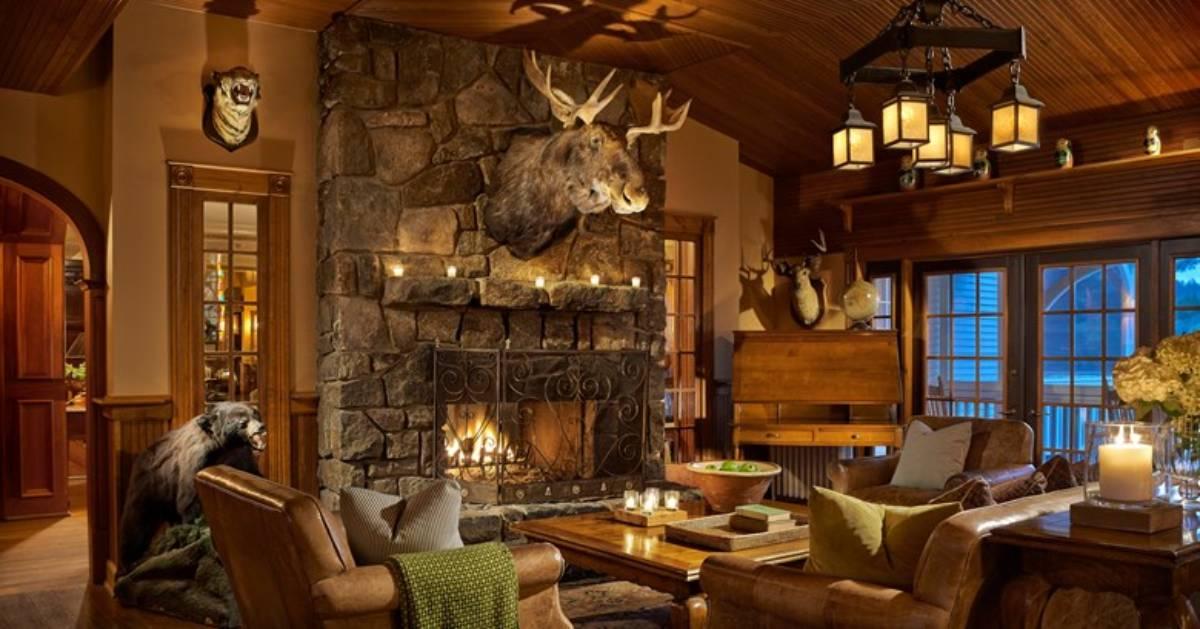 rustic Adironadck room with moose head over fireplace