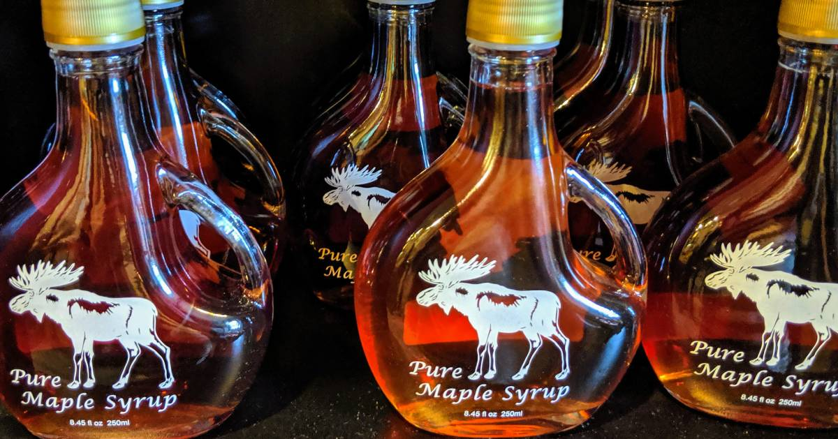 jars of maple syrup with moose on them