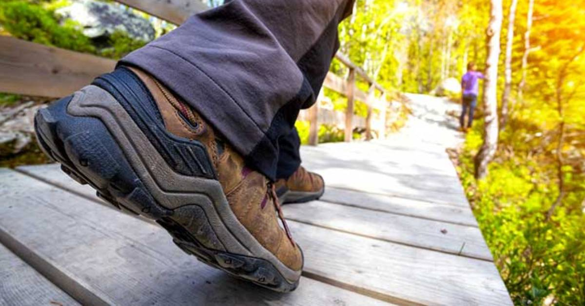 Close up of new hiking boots on wooden pathway