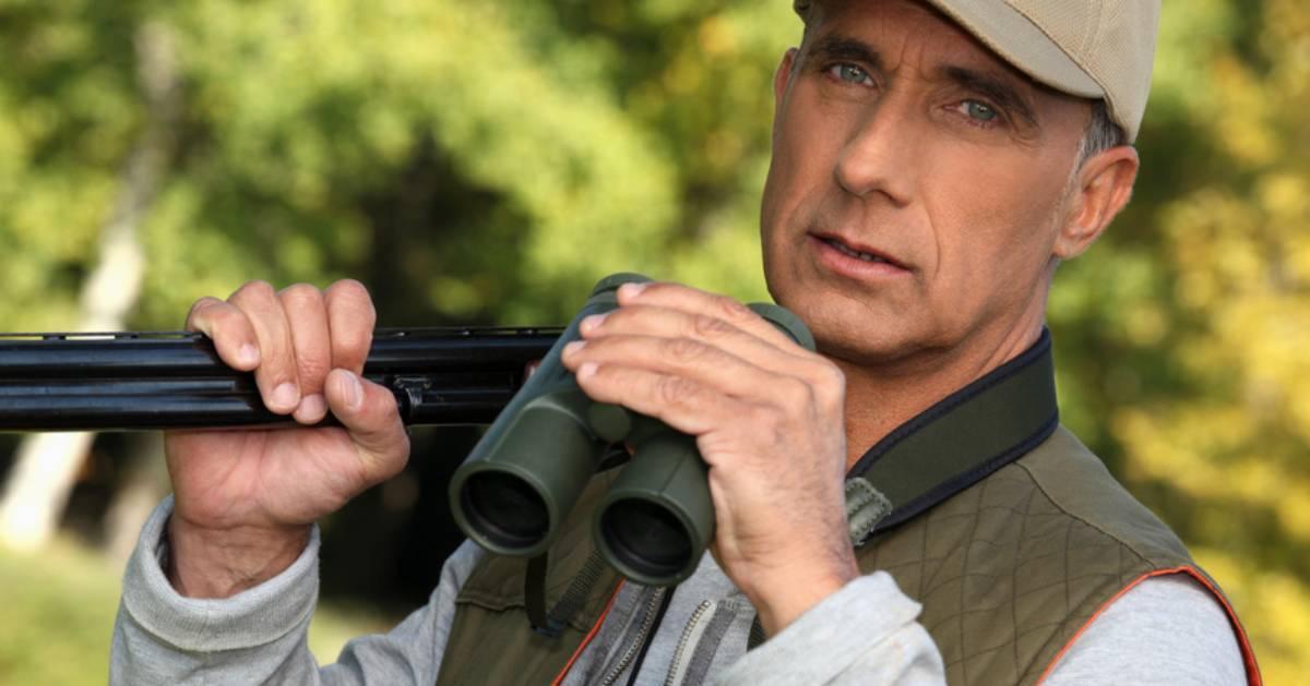 hunter with gun and binoculars