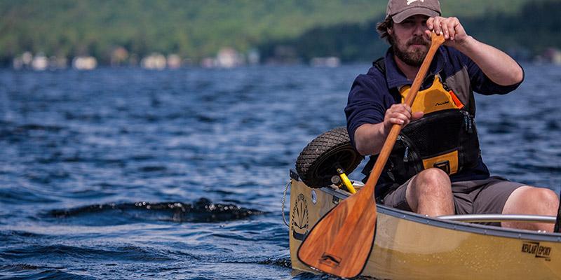 solo paddler through a lake