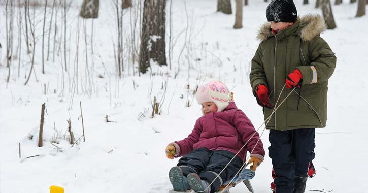 kid pulling a sled