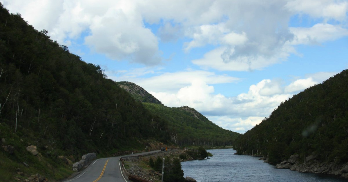 a road along the water near lake placid