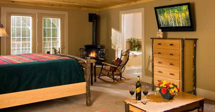 rustic guest room with fireplace