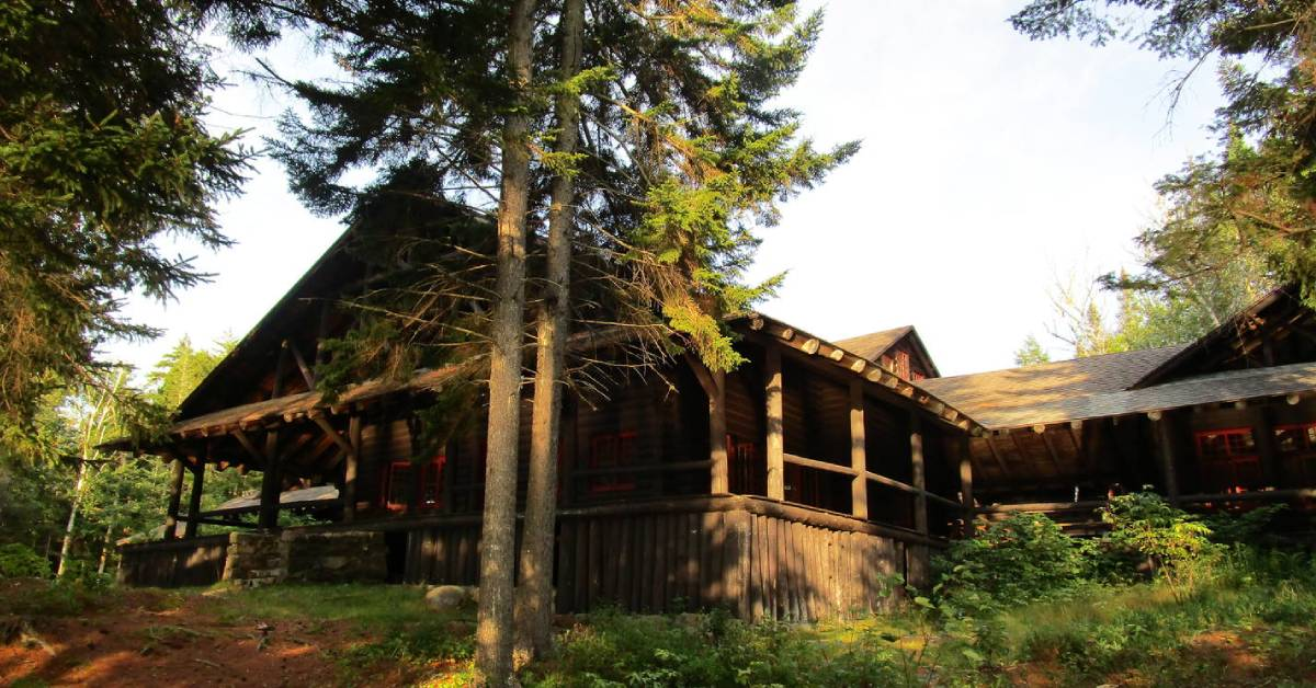 a wooden building in the woods