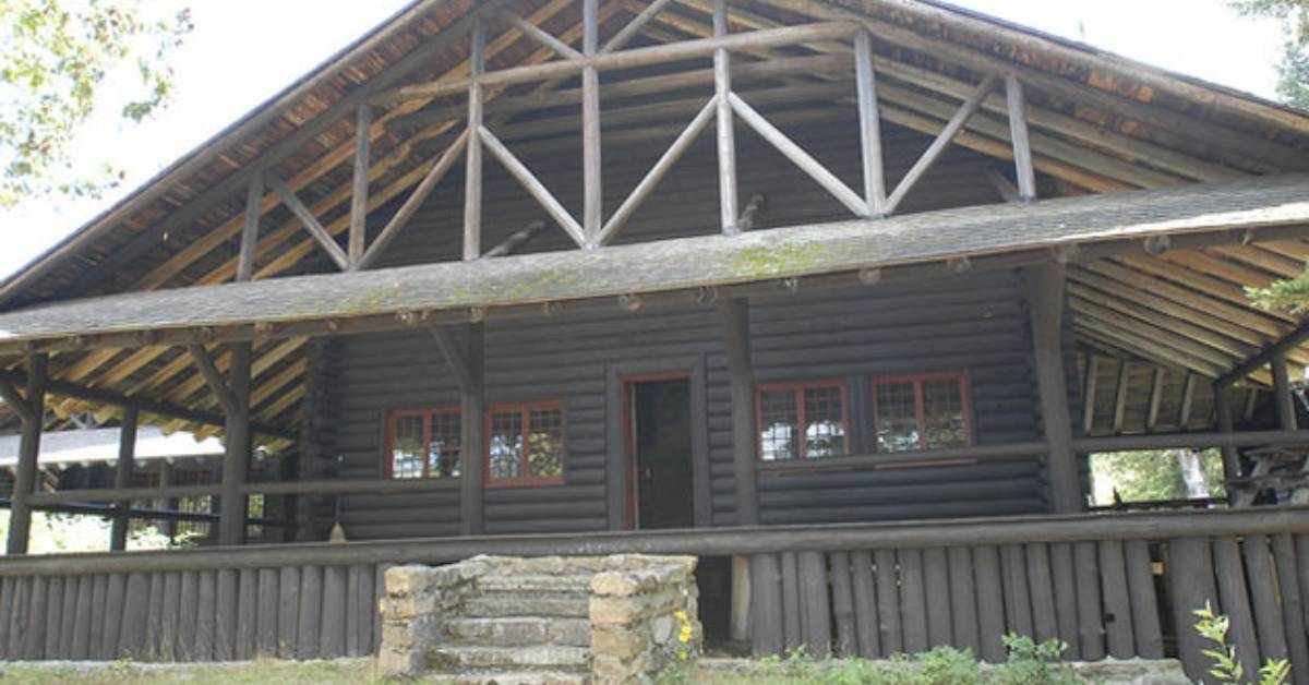 the front of a dark wooden rustic building