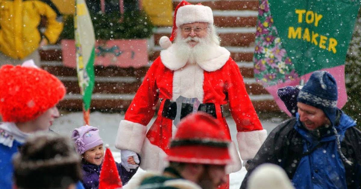 Santa walking with crowd in snow