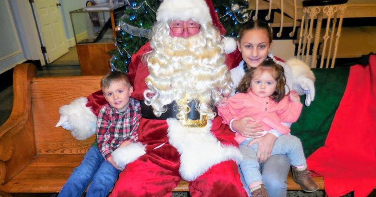 Santa sitting with kids and mom