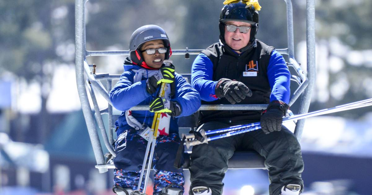 man and boy on ski lift