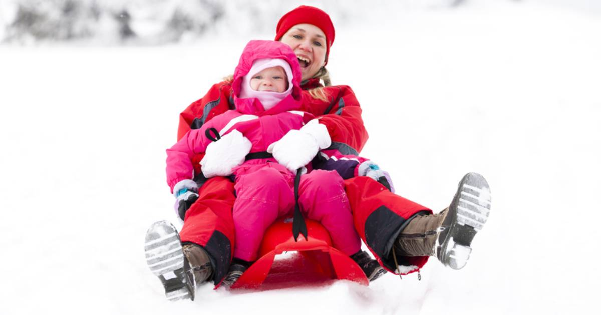 mom and daughter on sled