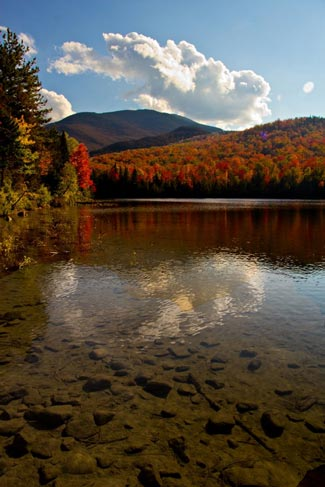 clear waters lined by fall foliage