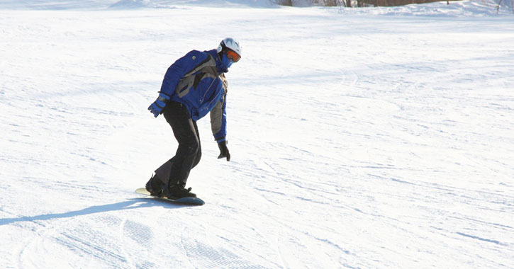 a snowboarder traveling down a hill
