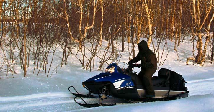 a lone snowmobile rider
