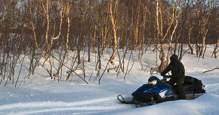 a rider on a snowmobile