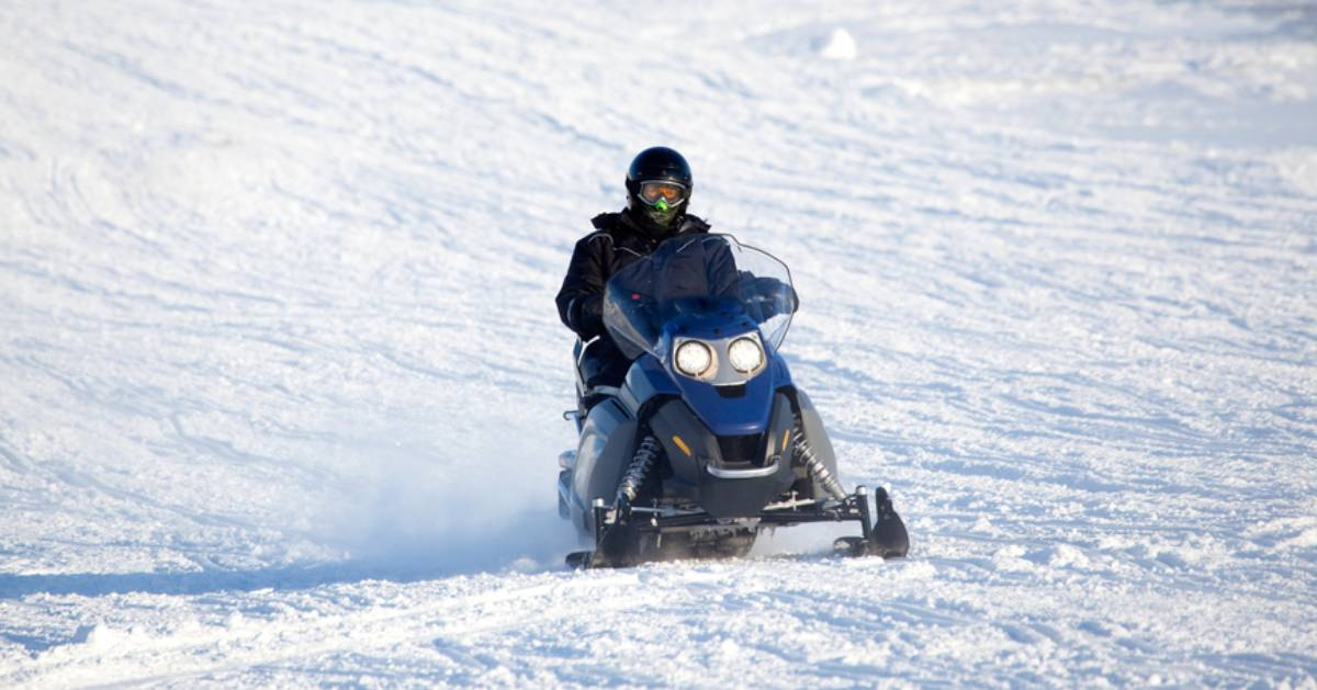 guy snowmobiling