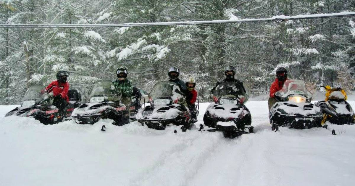 snowmobilers in a row