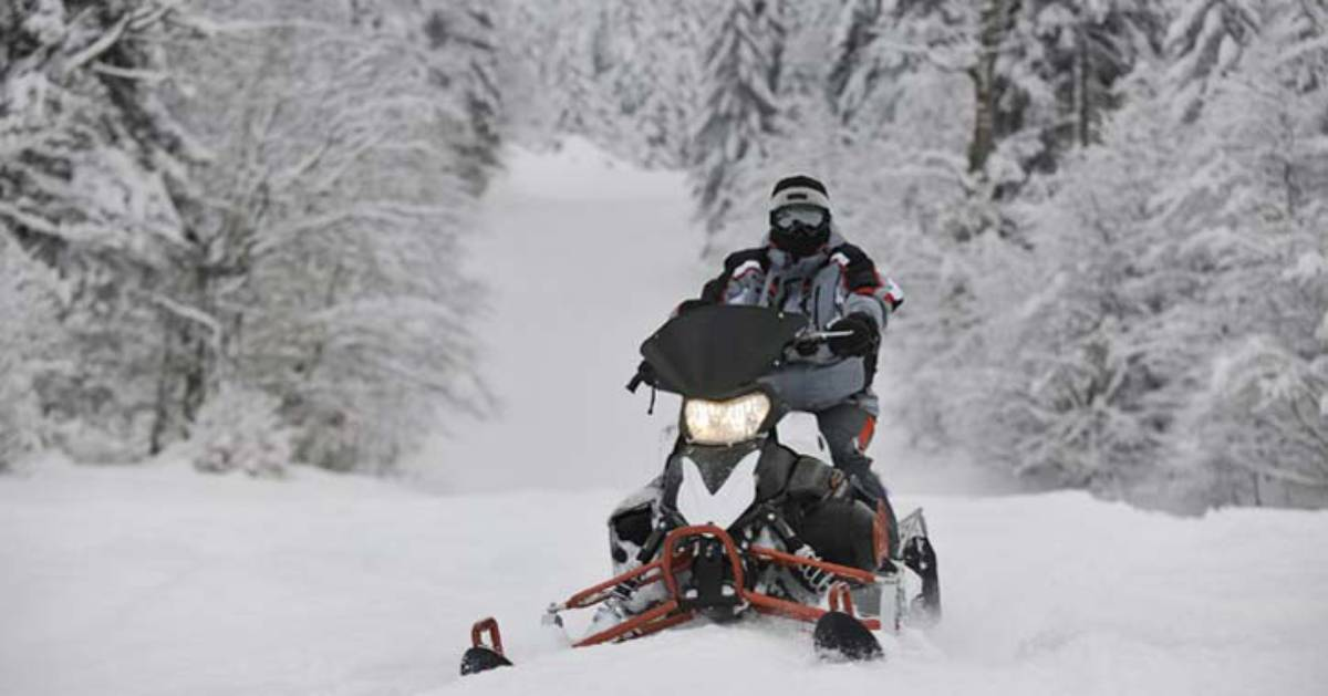 snowmobiler on route