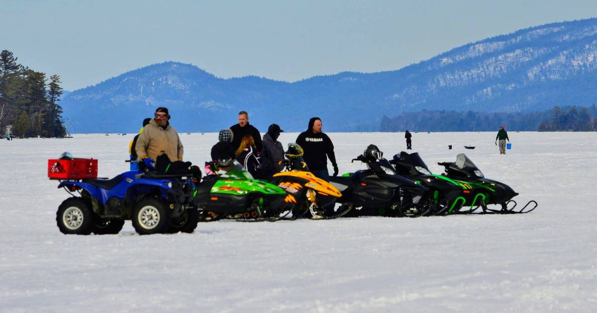 snowmobilers on lake