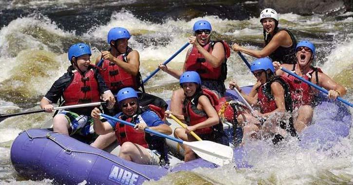 splashing in a whitewater rafting trip