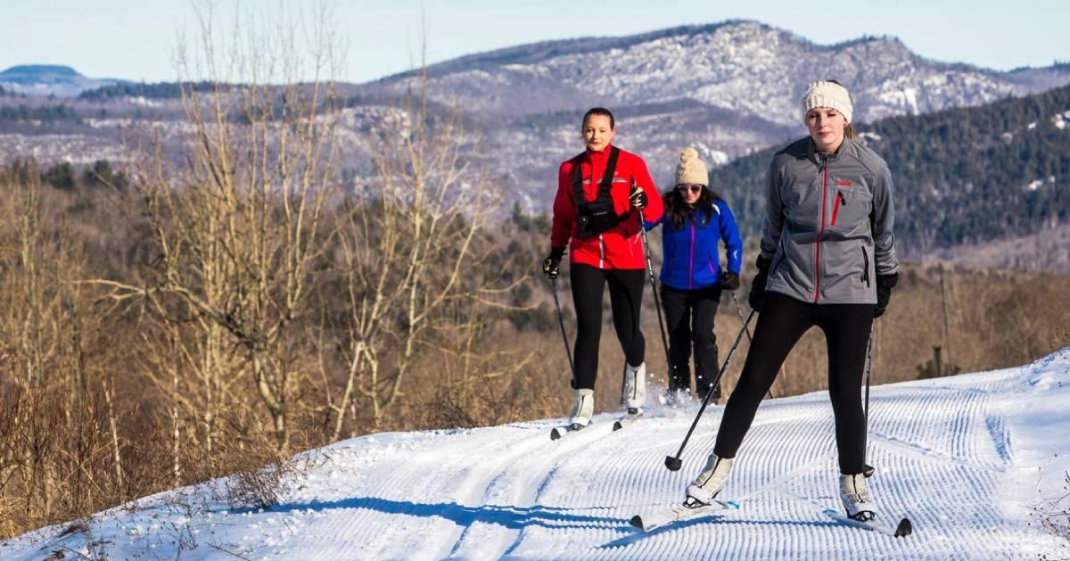 three cross-country skiers