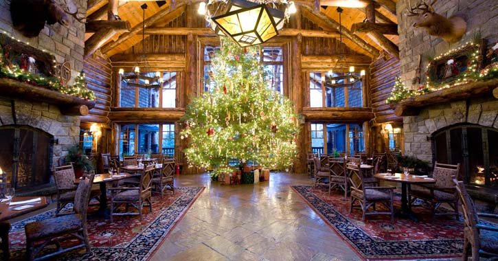 christmas tree inside a rustic dining room