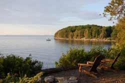 Adirondack chairs overlooking a lake